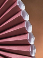 close-up of mauve honeycomb shades