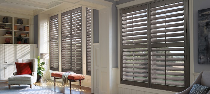 plantation style hardwood shutters in a sitting room