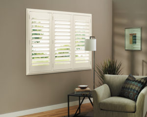 white interior shutters in a living room