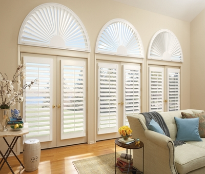 arched plantation shutters in a living room