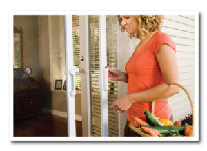 Woman-closing-retractable-screen