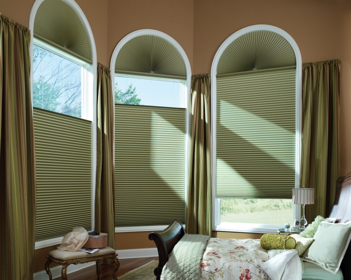Honeycomb shades in a bedroom