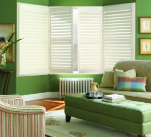 polysatin shutters in a green living room