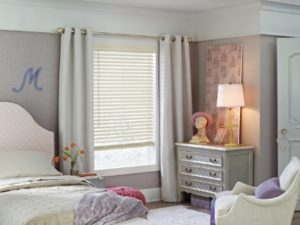 faux wood blinds in a bedroom